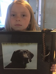 Photo of 8-year-old Roxy Marie and dog Abby, who was killed by M-44 in this spot